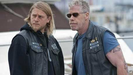 Charlie Hunnam, left, and Ron Perlman in