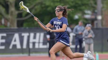 Olivia Carner #10 of Northport drives the ball