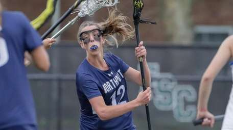 Danielle Pavinelli #12 of Northport drives on the