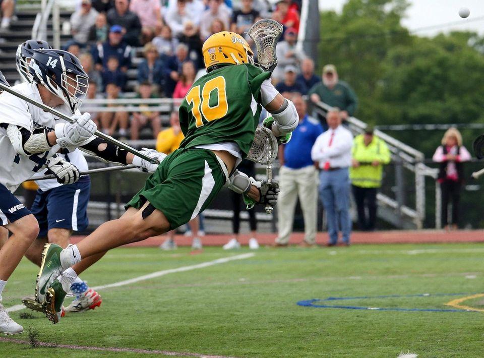 Ward Melville's Brandon Aviles puts the diving shot