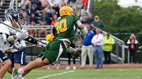Ward Melville's Brandon Aviles puts the diving shot