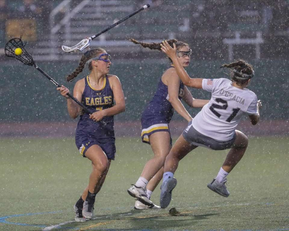 Lacey Downey #7 of West Babylon drives on