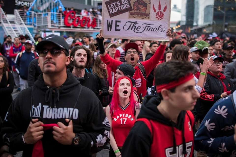Toronto Raptors fans gather outside Scotiabank Arena before