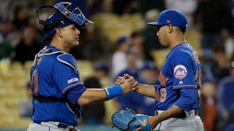 Mets relief pitcher Edwin Diaz, right, and catcher