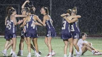 Bayport-Blue Point players celebrate after defeating Mount Sinai