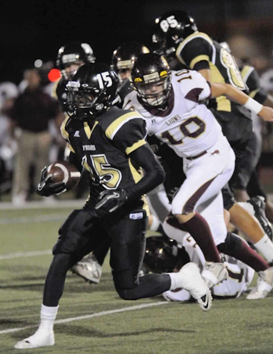 St Anthony's (L) #15 Stan Ridley rushes for