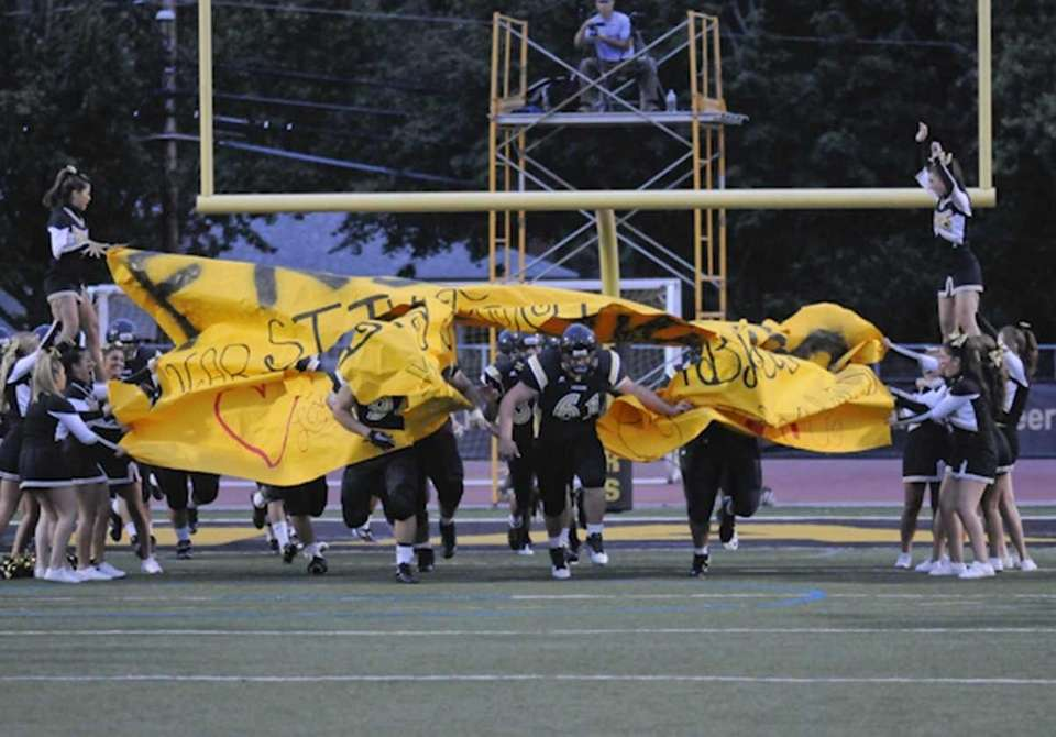 St Anthony's players take to the field during