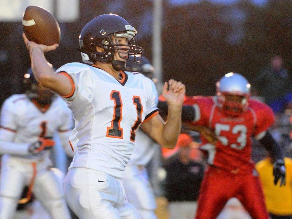 Babylon High School quarterback #11 Zach Fredericks throws