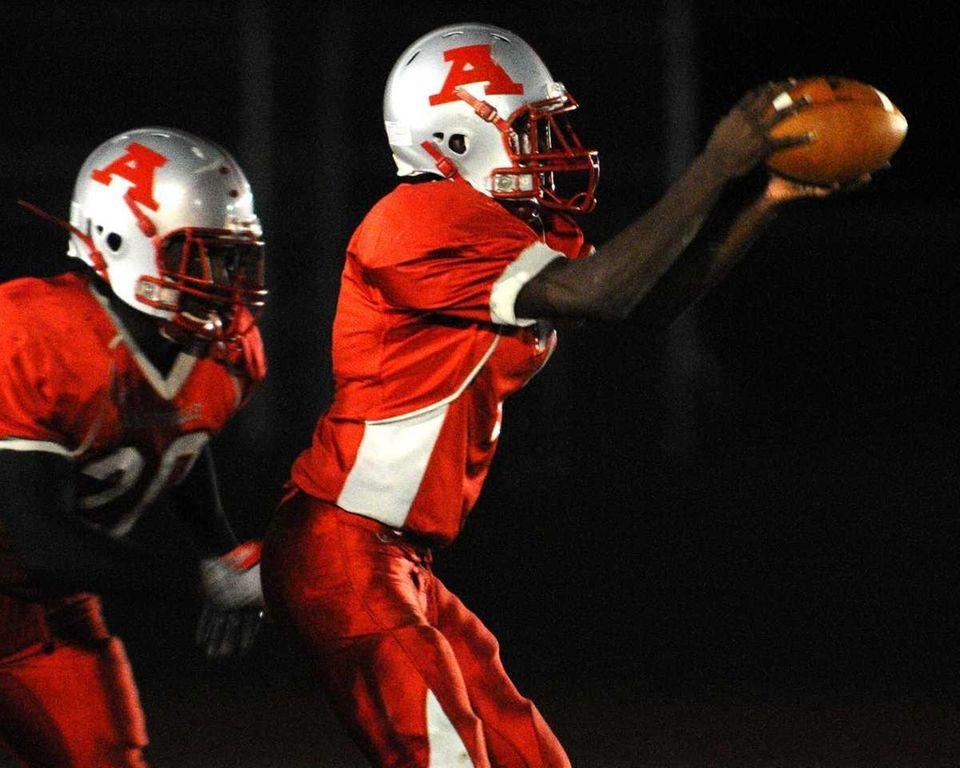 Amityville High School quarterback #7 Sean Walters, right,