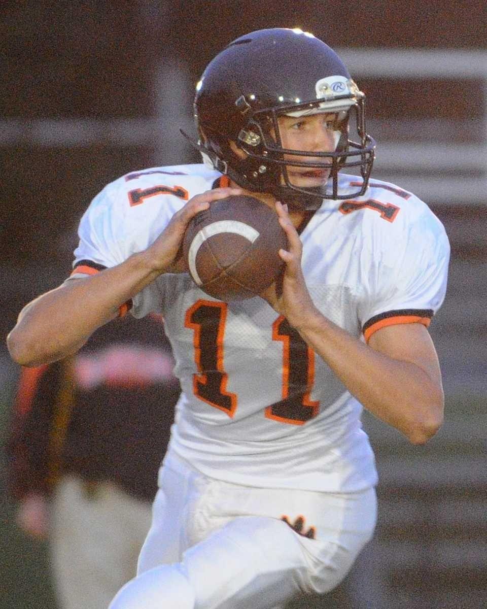 Babylon High School quarterback #11 Zach Fredfricks looks