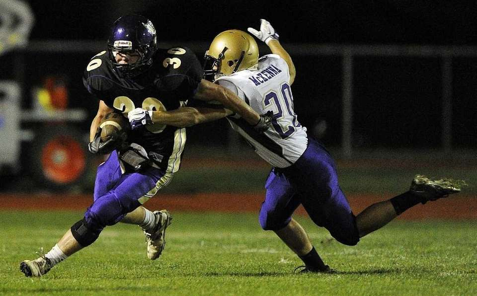 Islip's Johnny Maher tries to evade a tackle