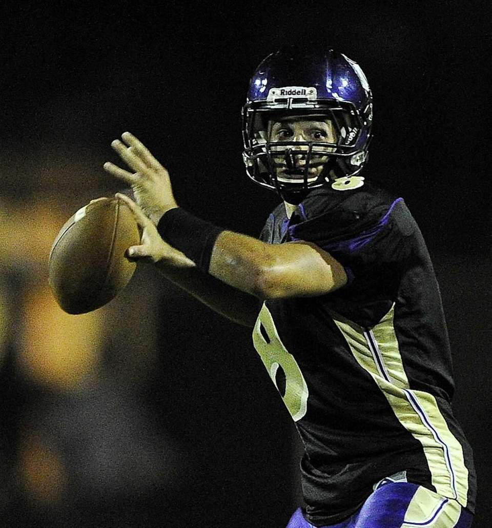 Islip quarterback Joe Sabbatino looks to pass against