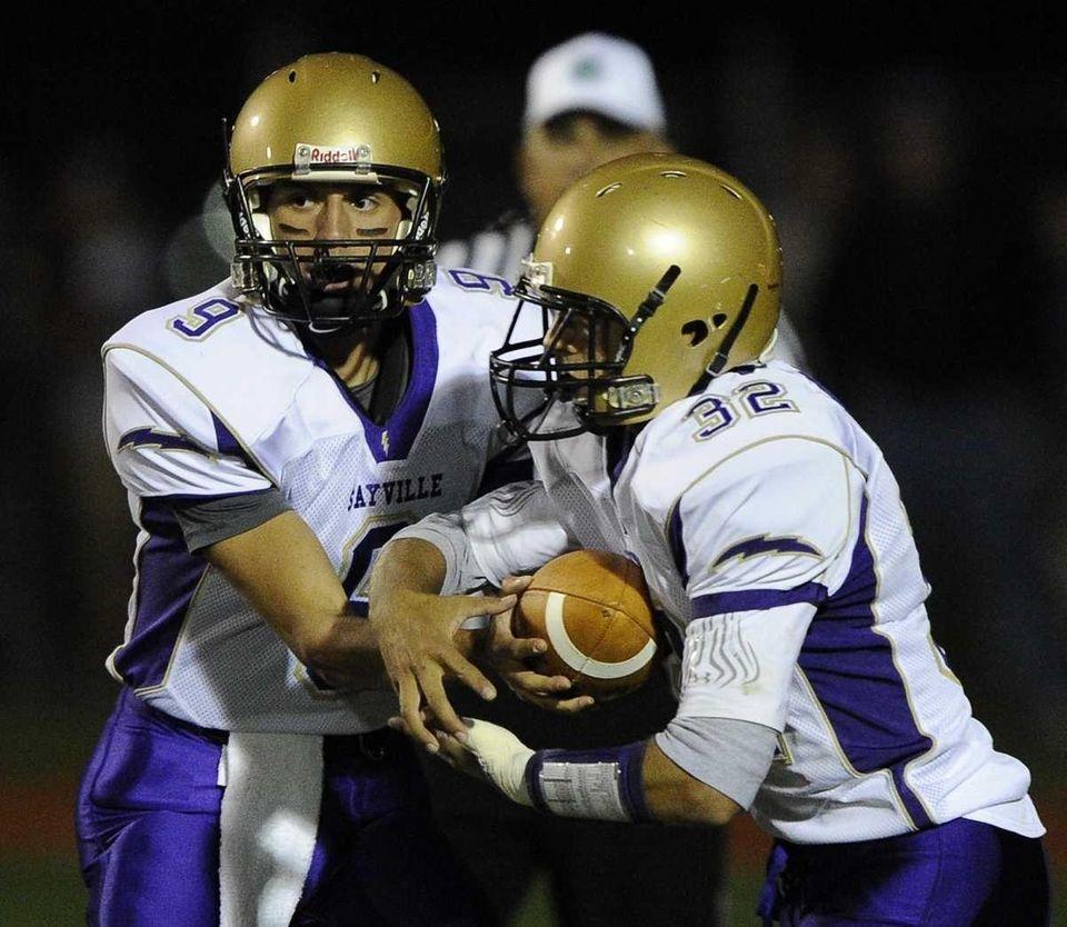 Sayville quarterback Steven Ferreira hands the ball off