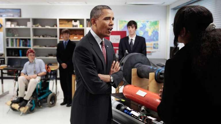 U.S. President Barack Obama talks with student Alexandria