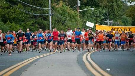 Participants begin the 34th Great Cow Harbor 10K