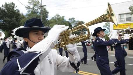 Members of the Huntington High marching band march