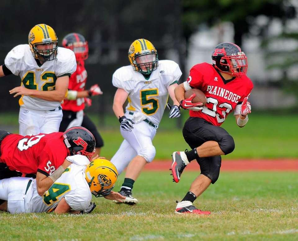 Plainedge's Gianfranco Soriente pulls away from Lynbrook's (l-r)