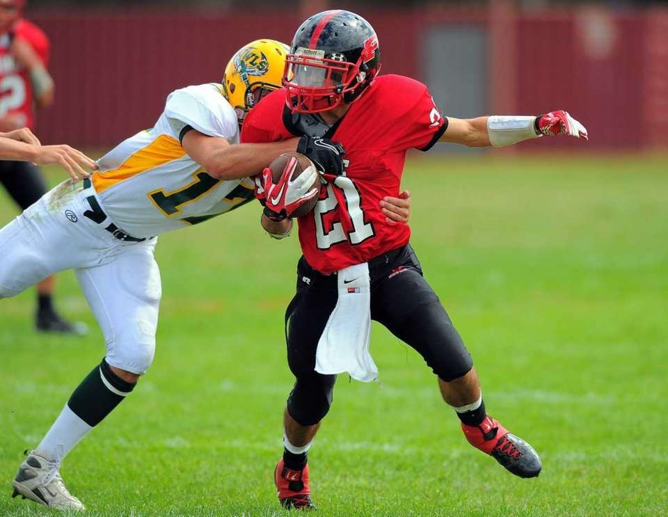 Plainedge's Ralph Caccavale tries to pull away from