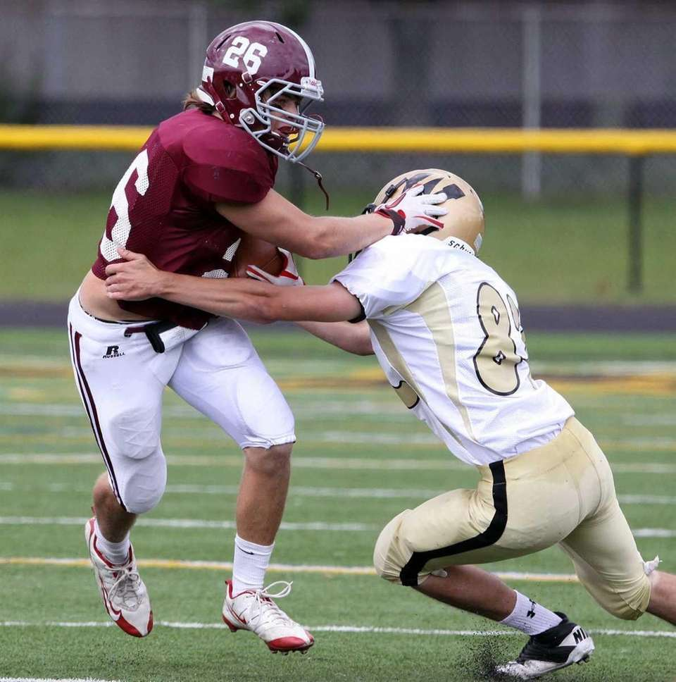 Garden City's Patric Berkery breaks a tackle during