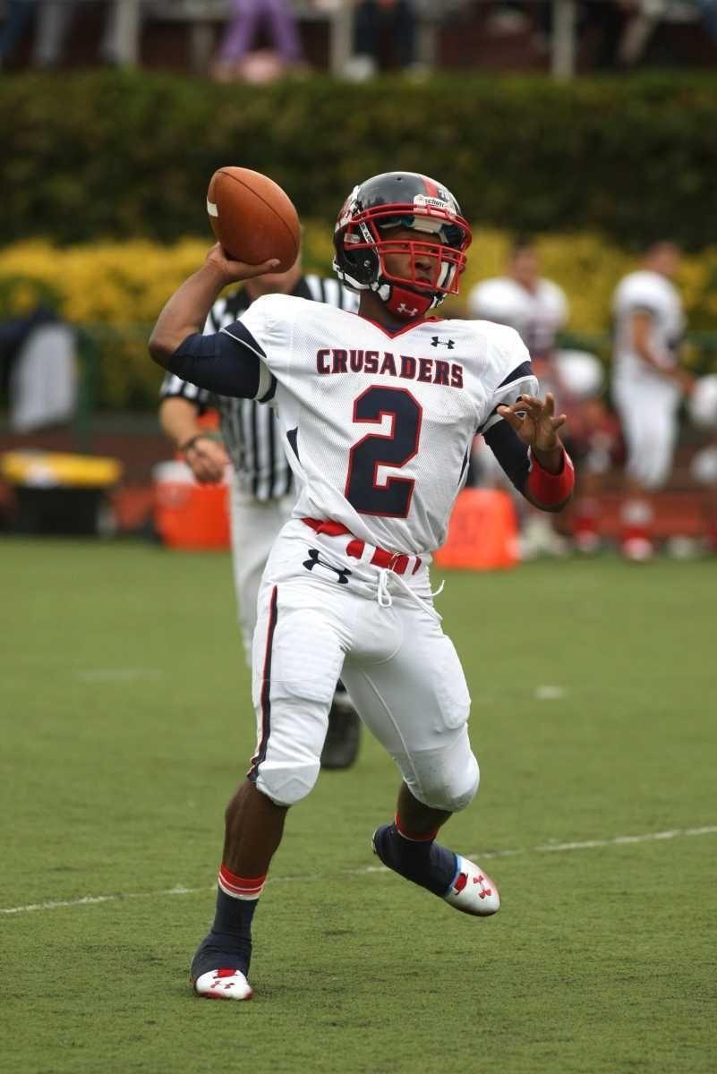 Stepinac quarterback Mark White throws for a touchdown