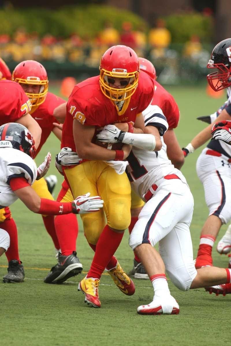 Chaminade quarterback Joseph Anile runs toward the endzone