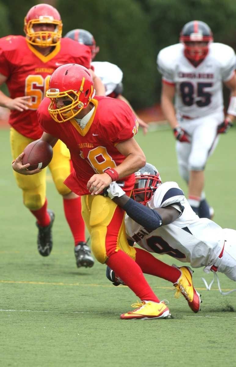 Chaminade quarterback Joseph Anile tries to escape the