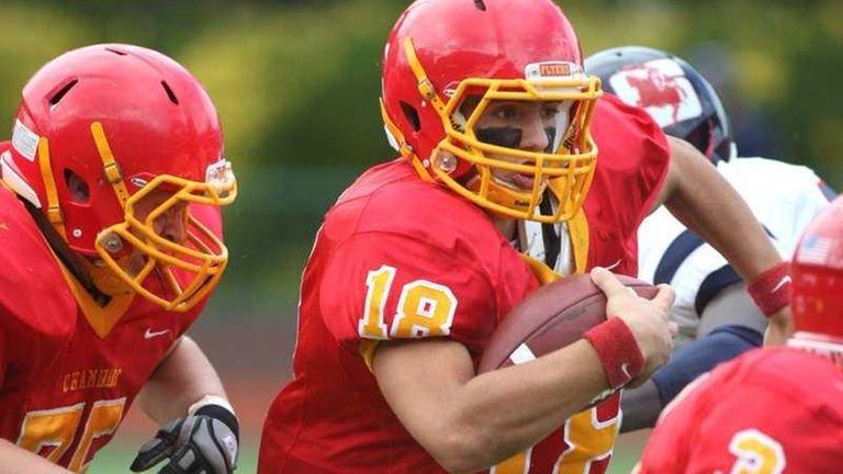 Chaminade quarterback Joseph Anile runs for yardage against