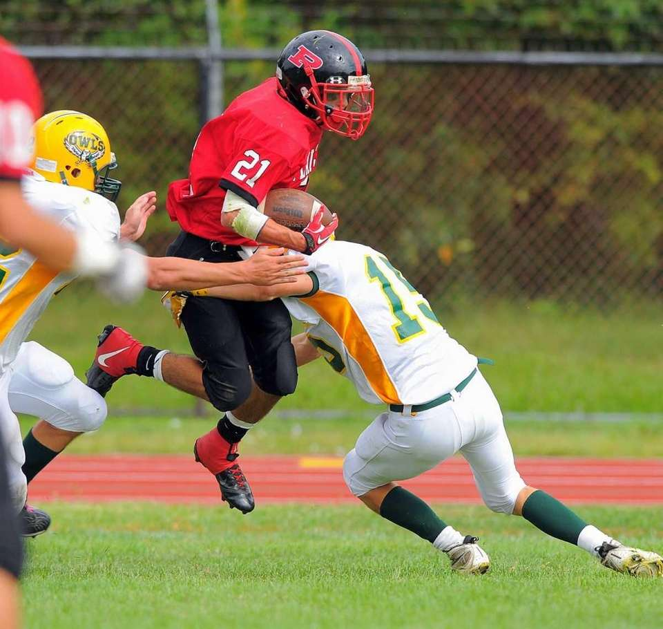 (l-r) Plainedge running back Ralph Caccavale is tackled