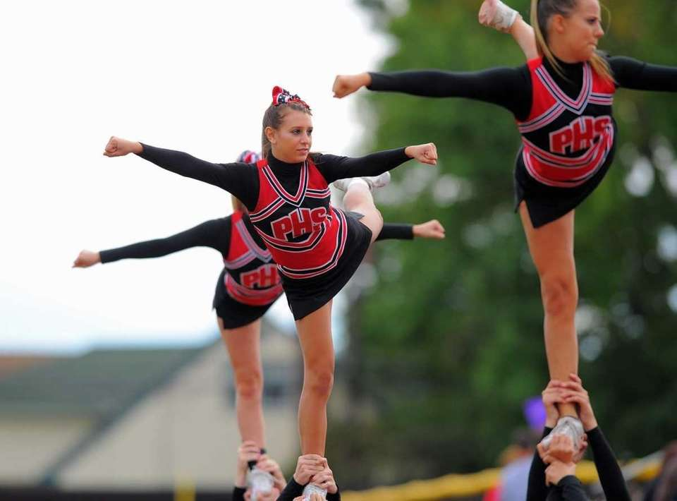 Plainedge cheerleaders perform during Lynbrook's 45-27 victory over