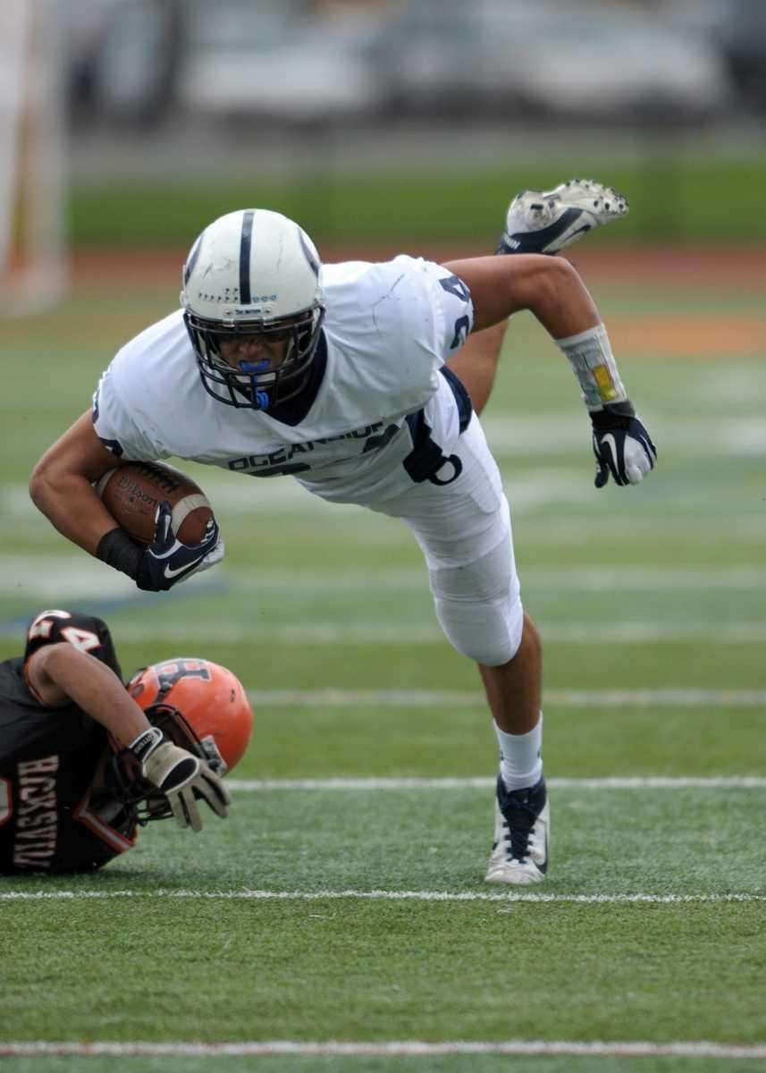 Oceanside's Justin Buckley (24) makes the catch and