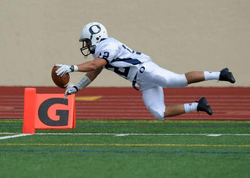Philip Ragona (12) dives for the endzone on