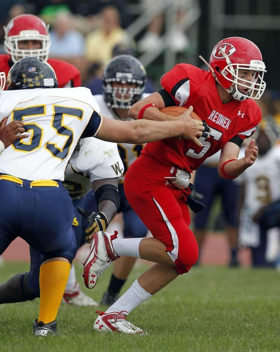 East Islip quarterback Pete Hannaberg (5) with the