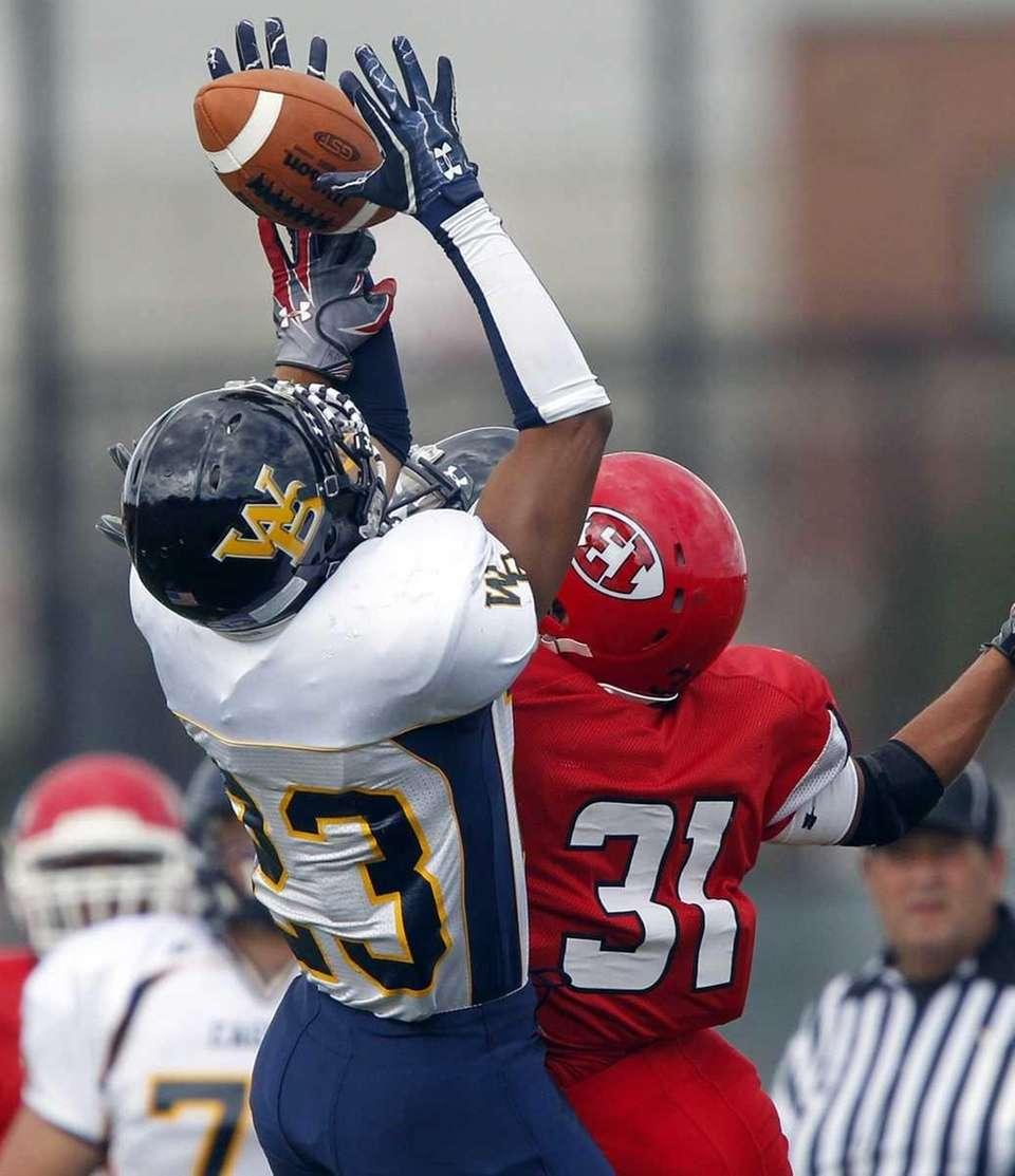 West Babylon's Rashaad Cooper (23) nearly steals the