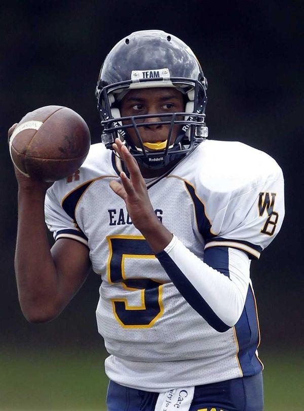 West Babylon quarterback Clifton Melhado (5) readies a