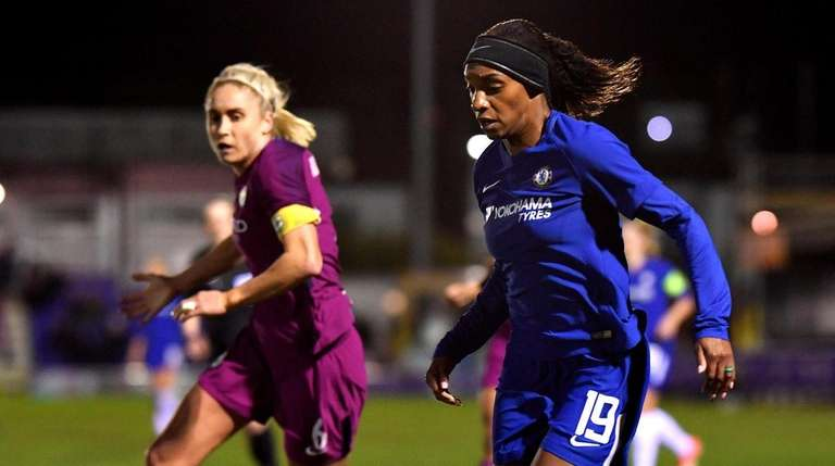 Crystal Dunn of Chelsea Ladies goes past Steph