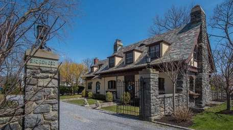 The four-bedroom 2½-bathroom Tudor features metal gates with