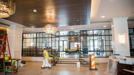 Workers put finishing touches on the lobby at