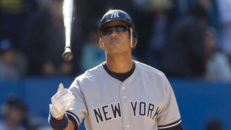 New York Yankees' Alex Rodriguez tosses his bat