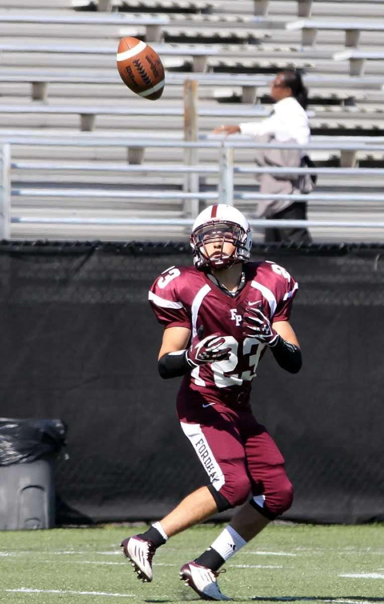 Fordham's Francis Volpe hauls in long pass against