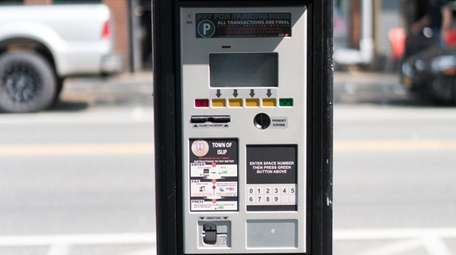 Parking meters along Bay Shore's Main Street, pictured