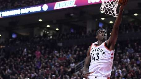Raptors forward Pascal Siakam lays the ball in