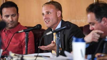 Acting City Manager Rob Agostisi speaks during the
