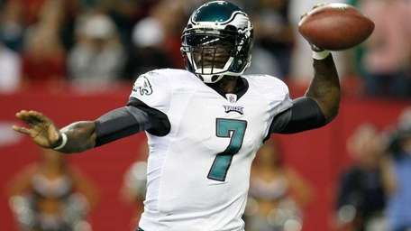 Michael Vick drops back to pass against the