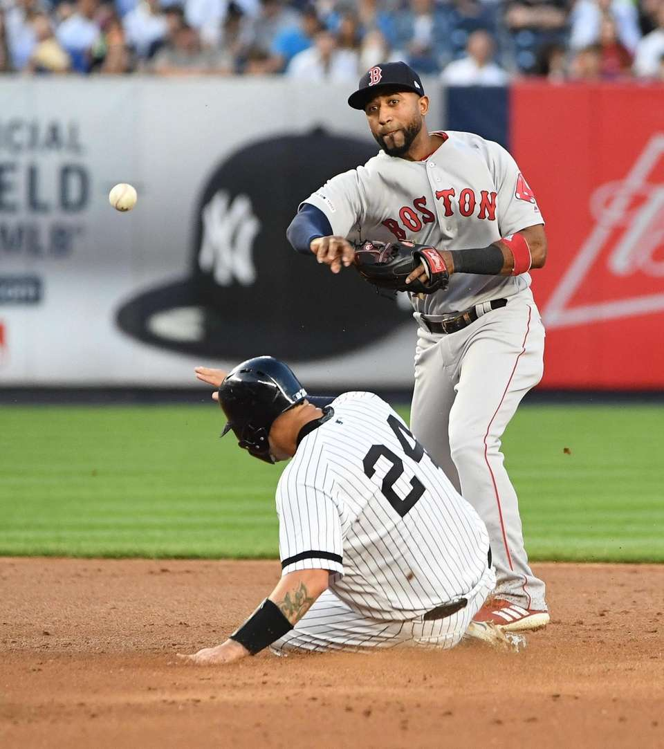 Boston Red Sox second baseman Eduardo Nunez forces