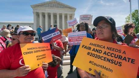 Immigration activists rally outside the Supreme Court as