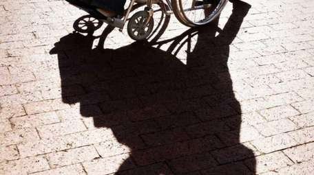 Person in wheelchair.