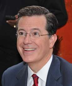 Actor/television personality Stephen Colbert signs autographs for fans