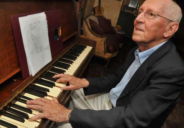 Ray DeForest, 86, sits at the piano with