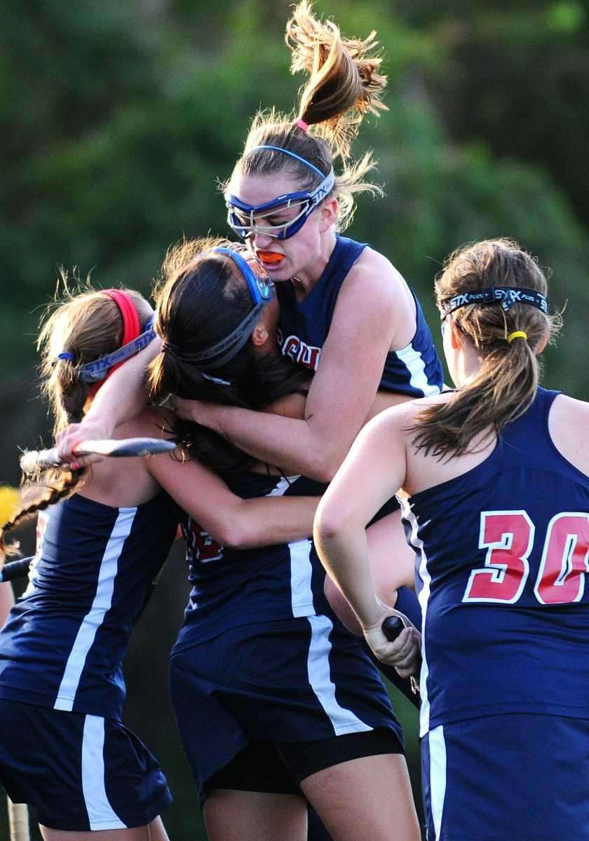 Cold Spring Harbor's Courtney Burke leaps in the