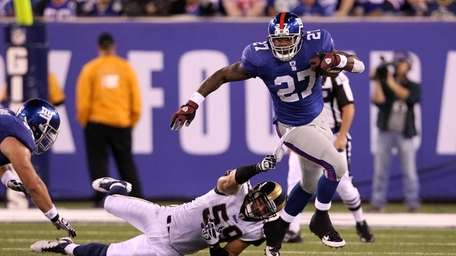 EAST RUTHERFORD, NJ - SEPTEMBER 19: Brandon Jacobs